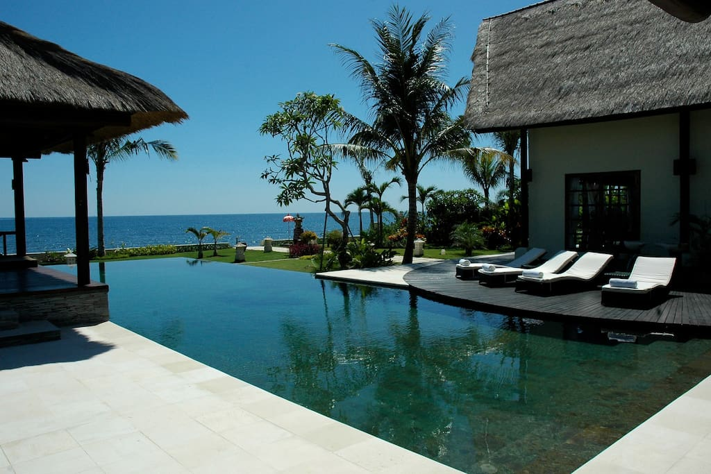 18 meter infinity pool surrounded by large pool deck and lush tropical garden