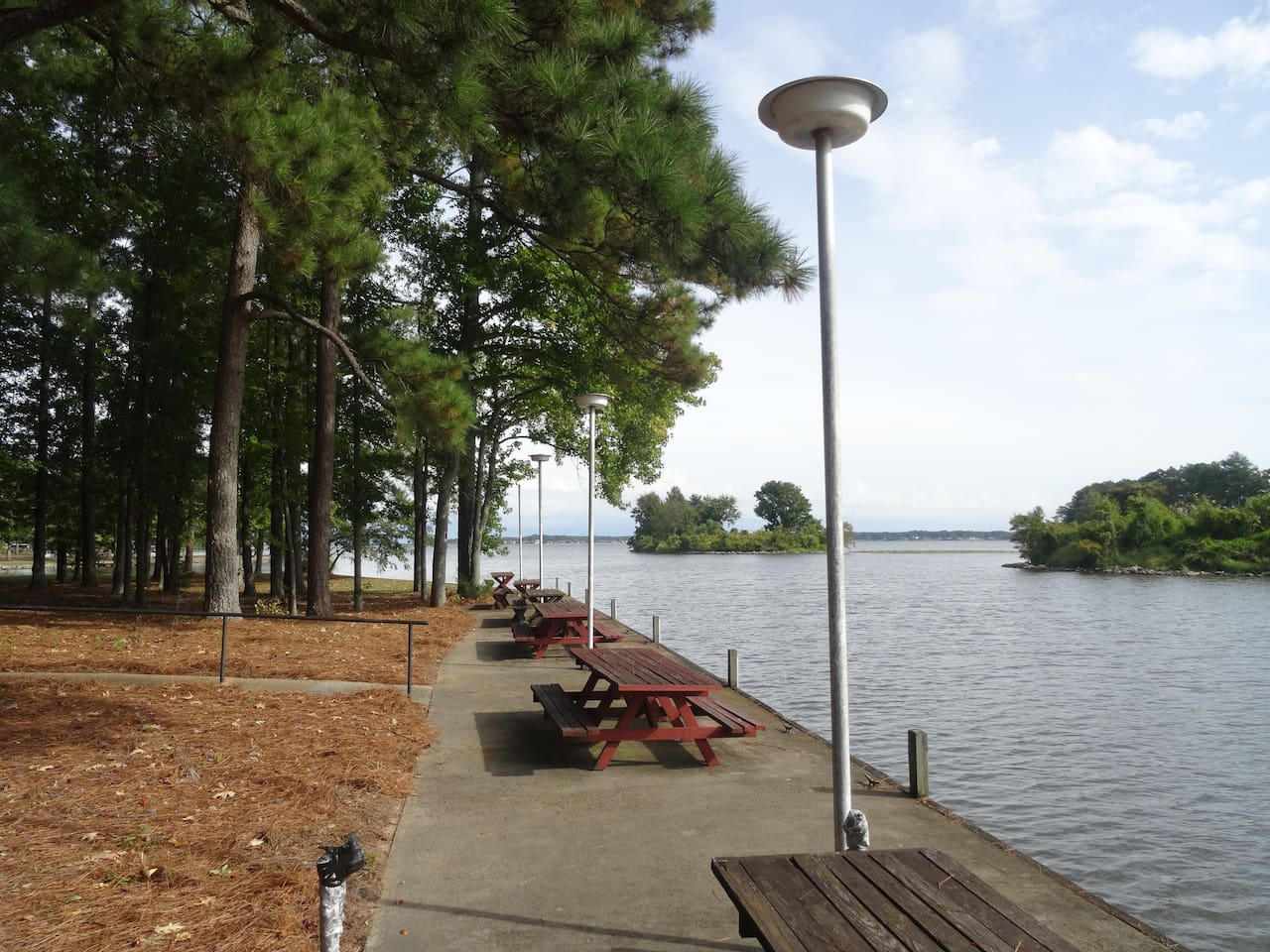 Large lake front complete with picnic tables and lights