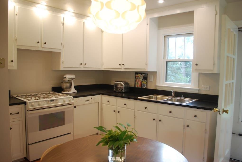 Recessed LED lighting and soapstone counters in the gourmet kitchen.