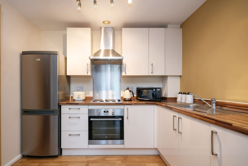 The theatre of your kitchen challenges.. with fridge freezer, oven and  microwave.
