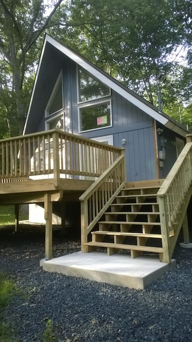 Six foot wide steps leading to the front door and a marvelous deck!