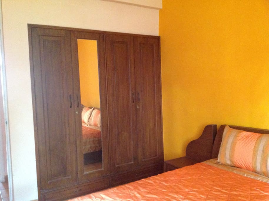 Master bedroom with air conditioner and cupboard