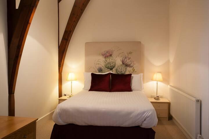 Master bedroom with original fixtures