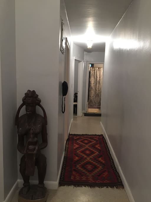 Hallway leads to kitchen and bathroom.