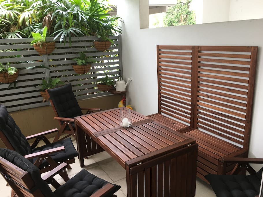 Outside under cover eating area with extendable table