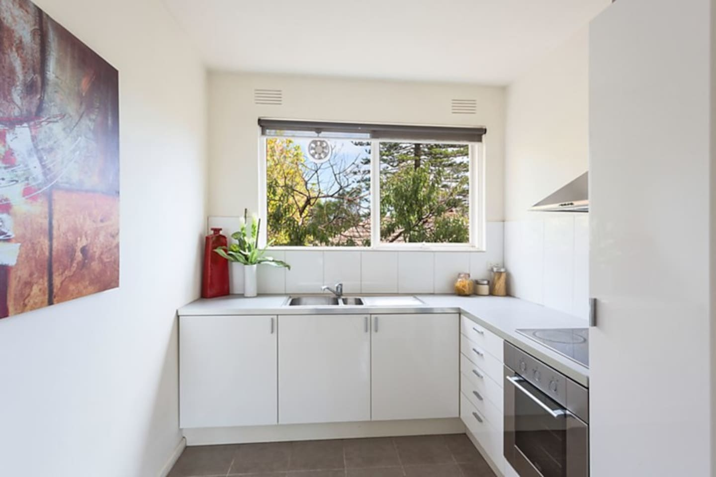 Bright and modern kitchen with all utilities and also a small breakfast table.