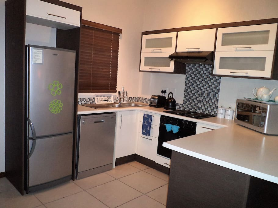 Dishwasher, electric stove,  kettle, toaster, microwave, refrigerator
