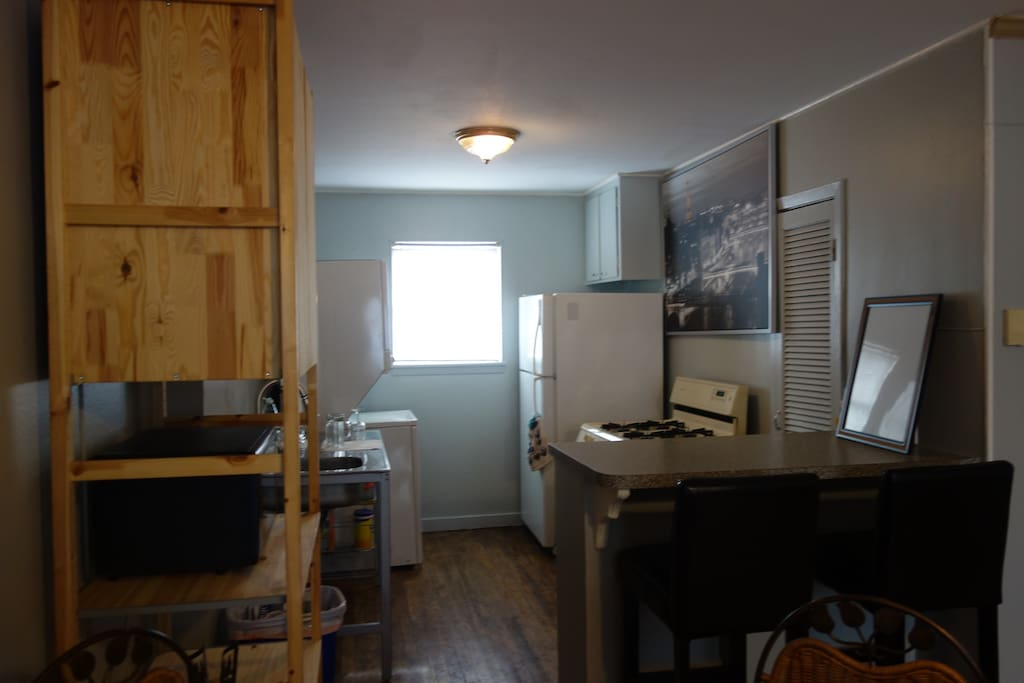 Kitchen has all your basic needs - microwave, coffee press, gas stove, fridge, and a washer/dryer.