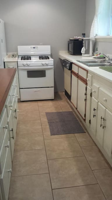 Walking into the apartment is the kitchen with stove, refrigerator, and dishwasher. All you need is the cook.