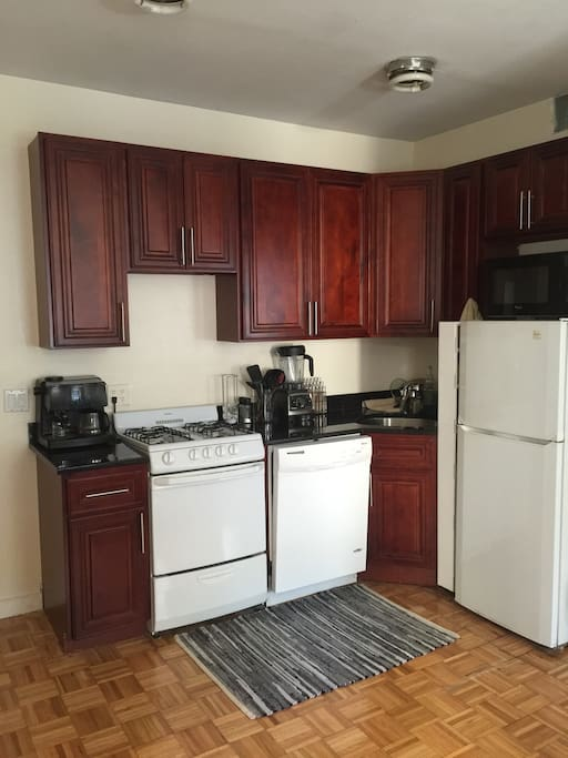 Open kitchen with a full sized dishwasher and gas stove