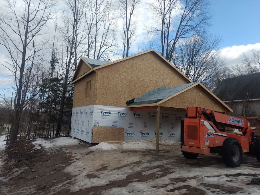 Another angle.  Doesn't look like much - but the interior wiring and rough plumbing has been getting installed.  Windows should be going in this upcoming week.  Stay tuned for more when there is really something to see.  Waiting for warmer weather to put on the siding - above 35 is preferred.
