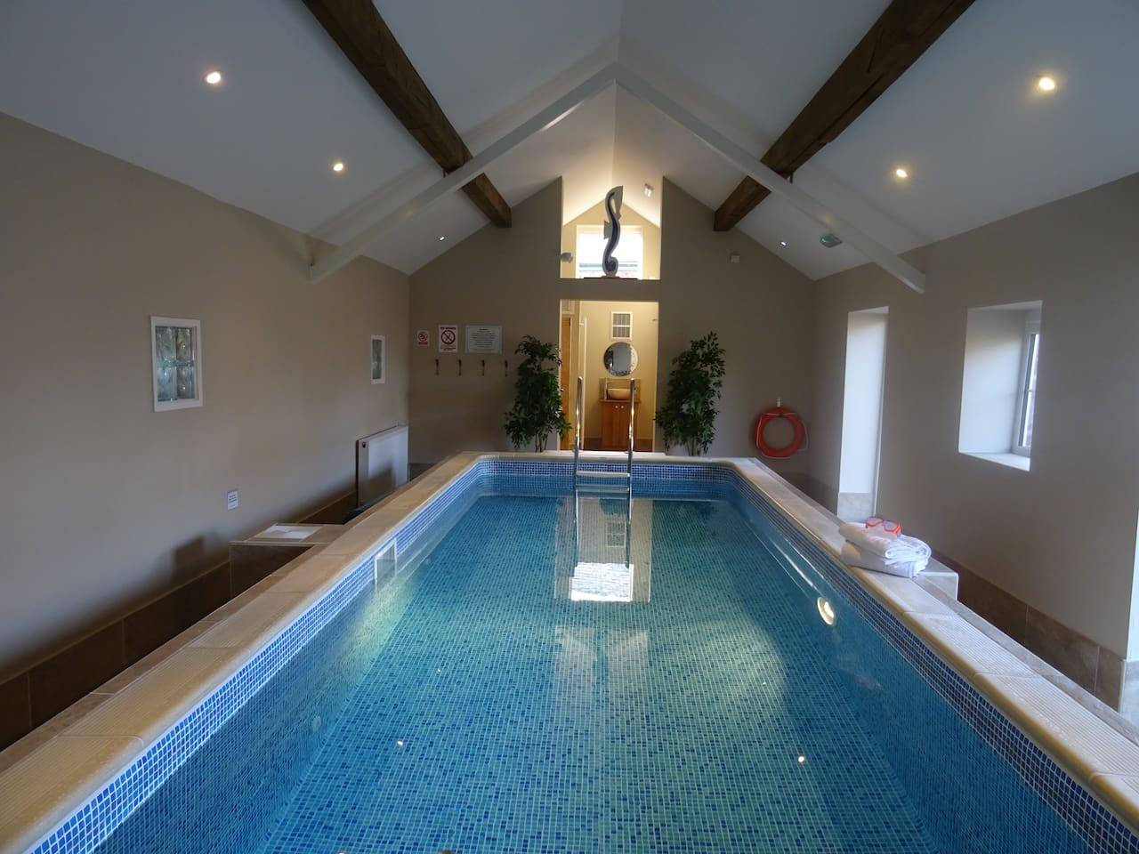 Indoor pool with changing rooms.