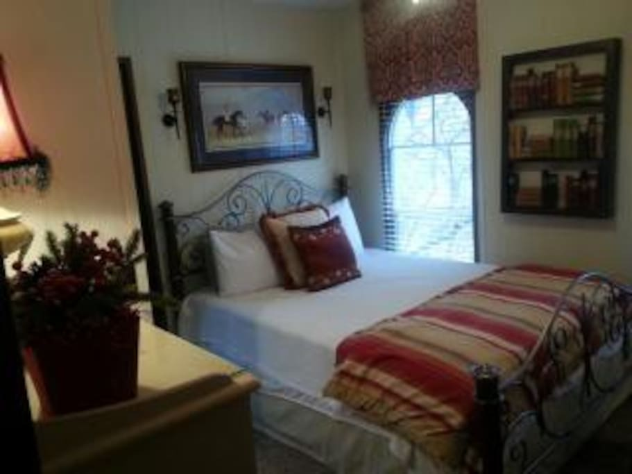 Guest Bedroom with queen bed and own bathroom