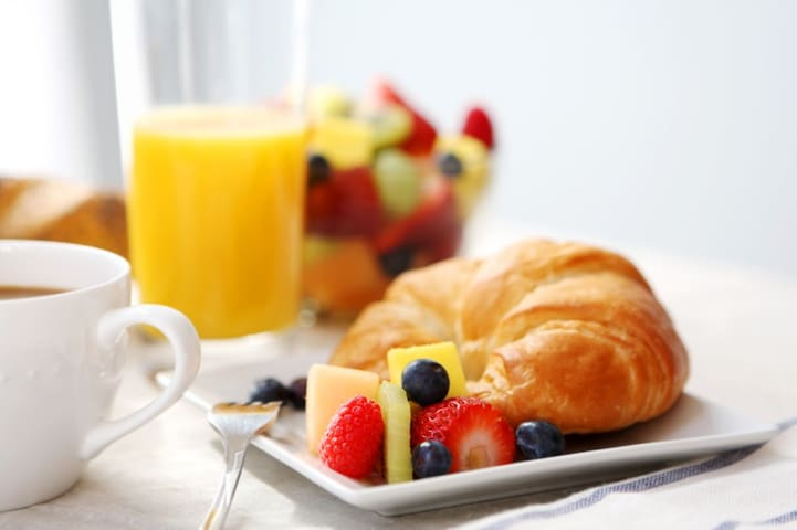 """Delicious complimentary continental breakfast consisting of croissants or muffins orange juice coffee or tea fruit & fabulous """"French style"""" yogurt & peanut butter."""