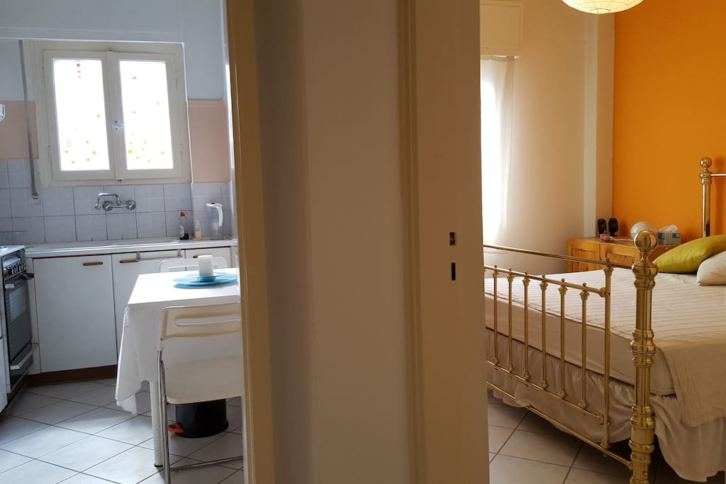 Master bedroom and kitchen