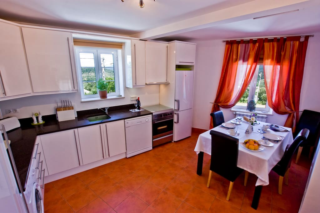 The open plan dining/kitchen area with stunning countryside views.