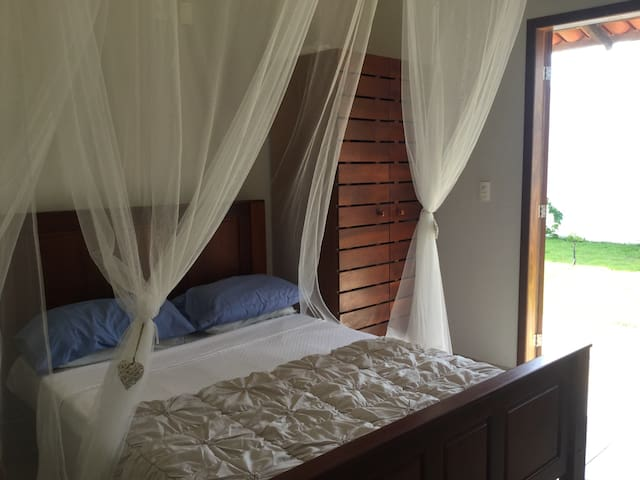 Bedroom two, all bedrooms with fans and mosquito nets