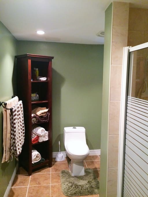 Private bathroom with shower next to bedroom