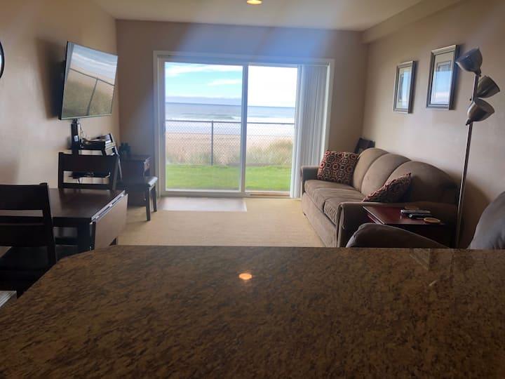 Panoramic beachfront, ground-floor condo