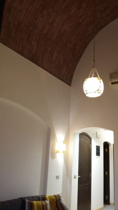 main living room with a double height Nubian vaulted celling .