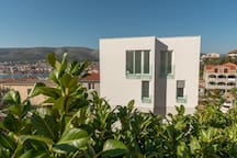 Our modern Villa from the outside with glass railing french balconies.