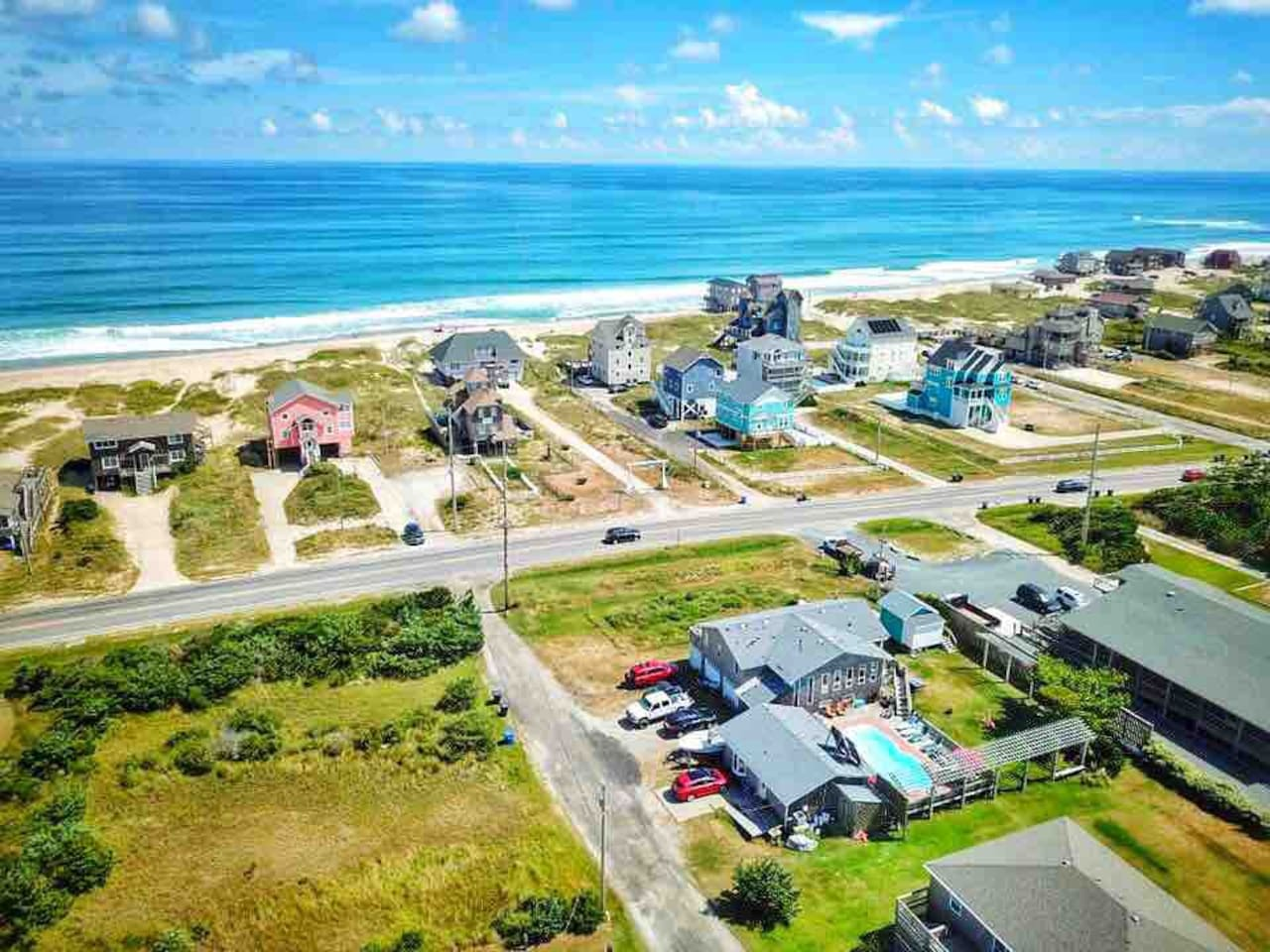 One house away, directly across the street from the ocean! Nowhere else on the obx will you be so close to both bodies of water!