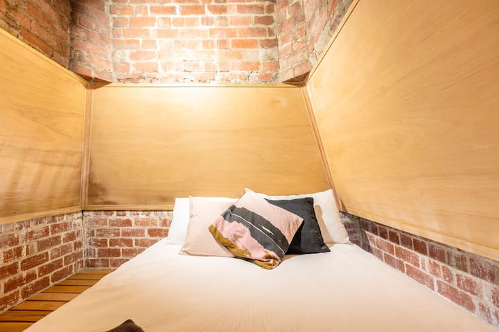 The loft retreat features a Queen size bed.