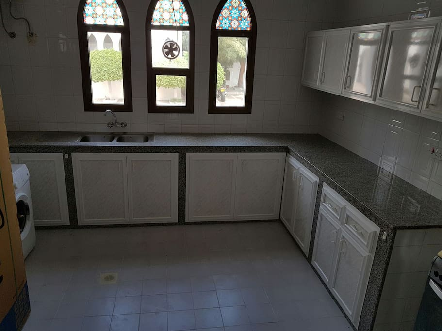 spacious kitchen with new fridge and washing machine. also had a gas range...