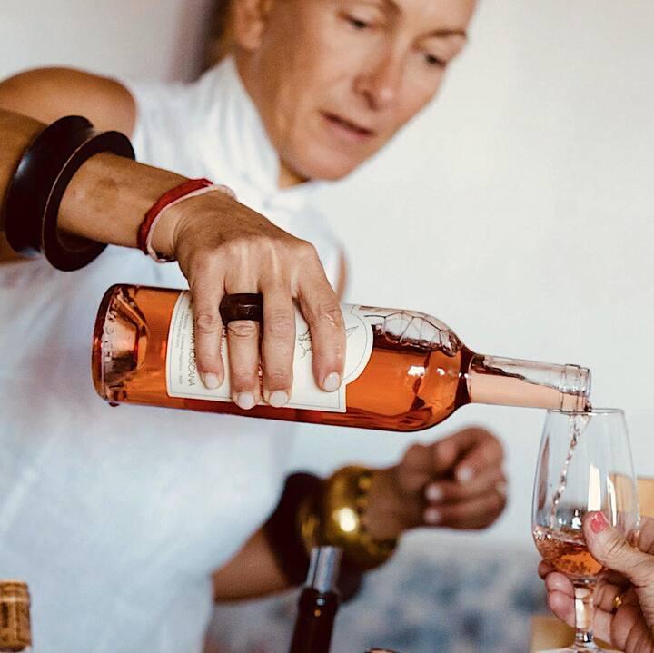 Cristina serving wine