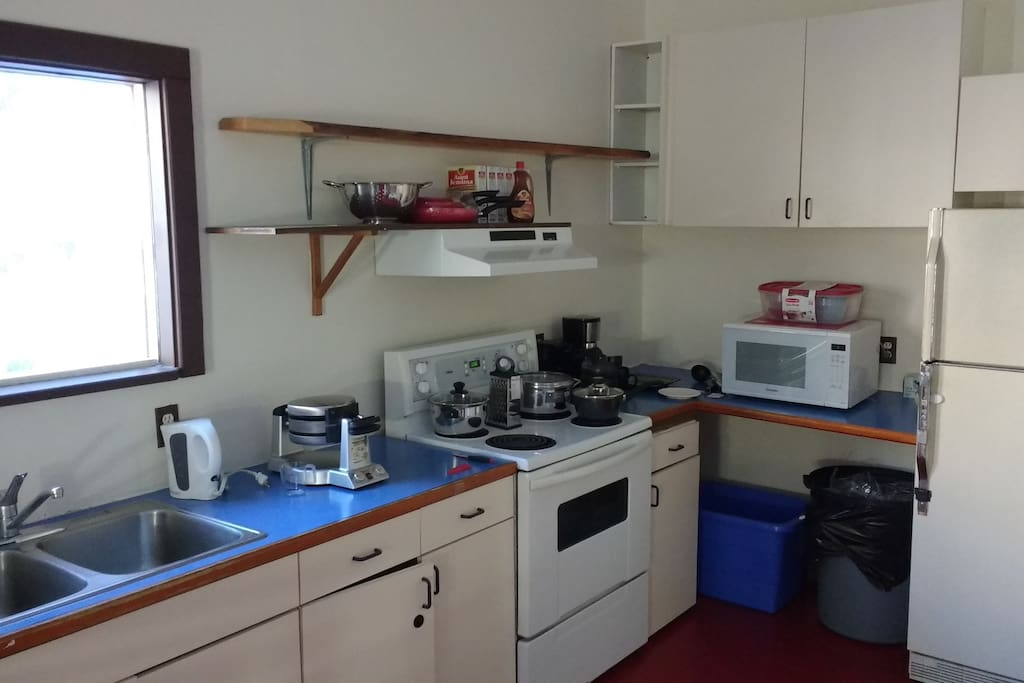 Open functional kitchen, shared facility. label ownership of food.
