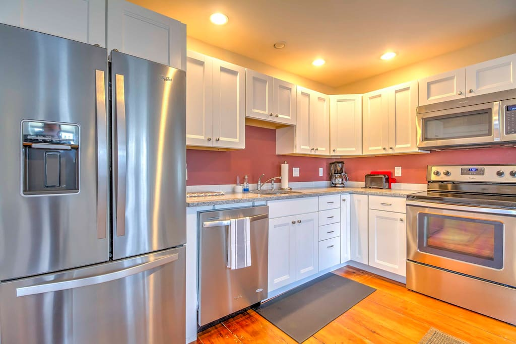 Prepare a home-cooked meal in the fully equipped kitchen with stainless steel appliances.