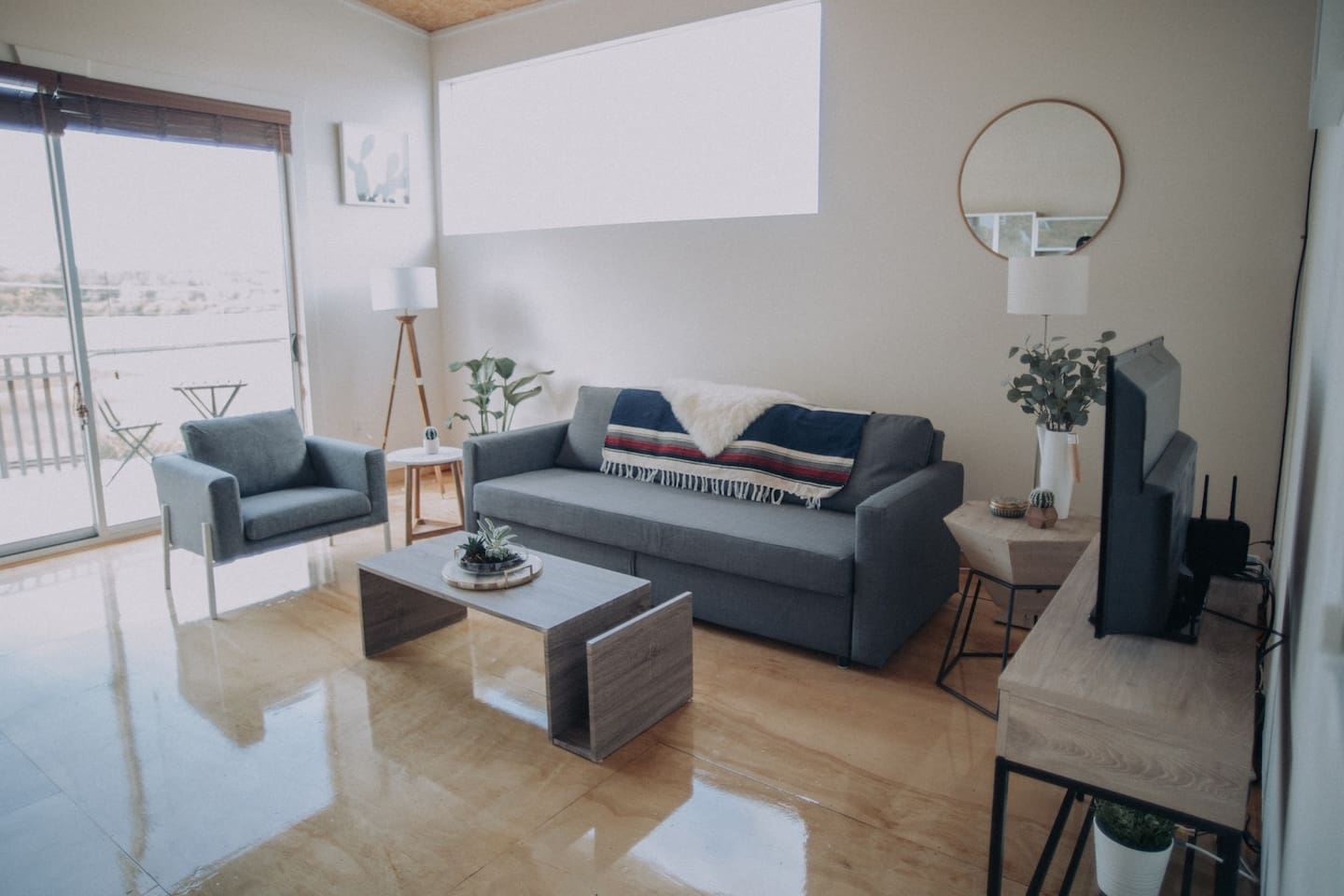 Open high-ceiling living room space
