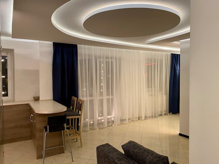 Уютная современная квартира-студия в центре города