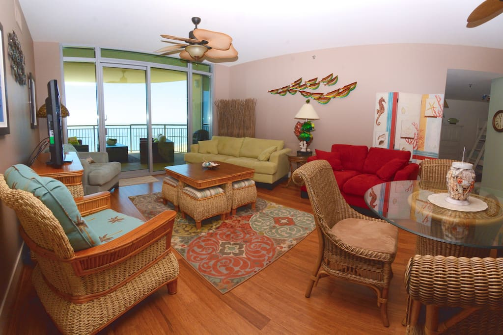 Living area with view of the Gulf - red foldout couch.