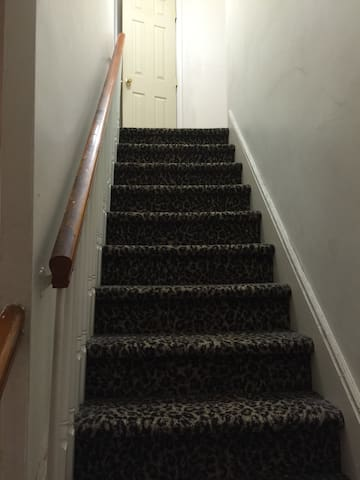 Stairs leading to 2nd floor for guests only.