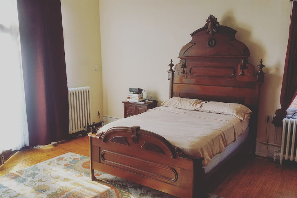 Bedroom: Full size Victorian bed across from the fireplace shown in the first photo
