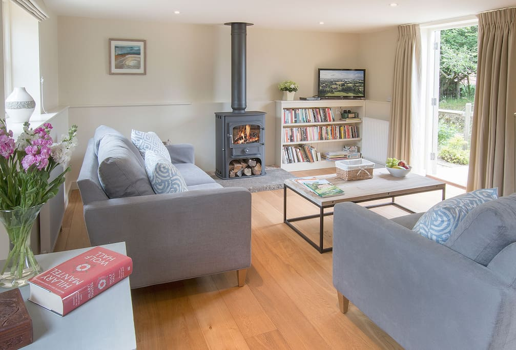 Ground floor:  Sitting room with dining area and wood burning stove