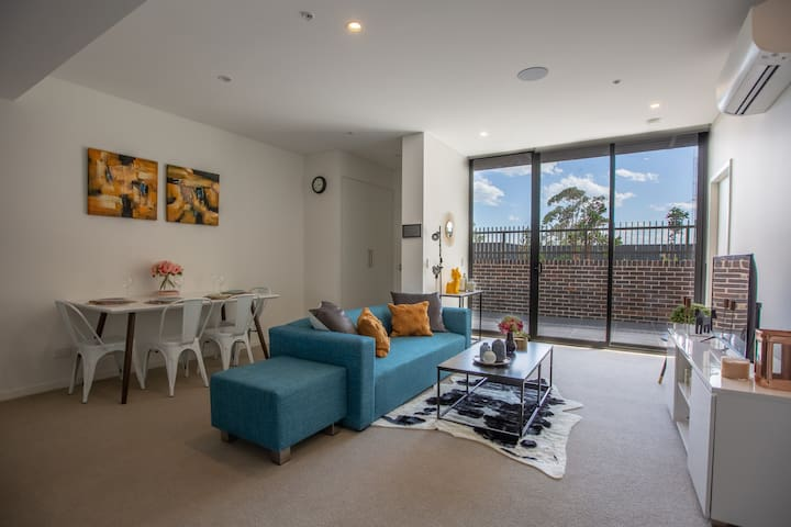 81 sqm in total with a spacious living room area with high ceilings & huge glass doors looking out to the terrace, allowing natural light in to brighten up the space.