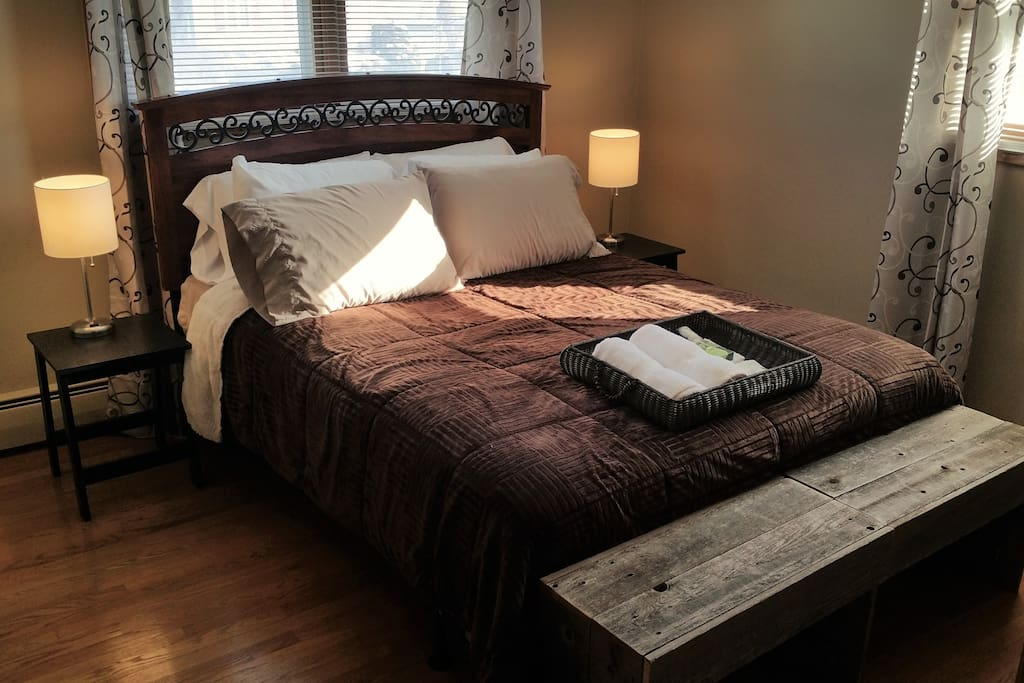 Comfortable Queen Bed integrated bedside lights and device charging
