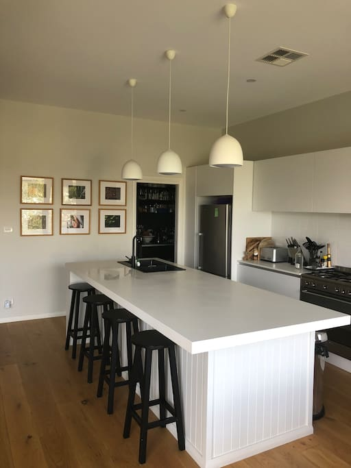 Open plan kitchen and pantry with oven fridge freezer and microwave