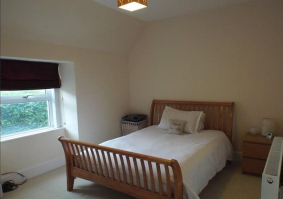 Spacious king sized bed, chest of drawers