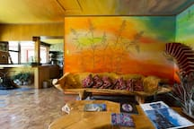The art on the wall is made with sand and the floor with individual pieces of wood.