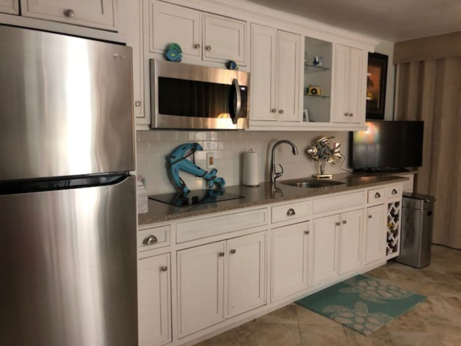 Beautifully updated cottage kitchen with all amenities and supplies