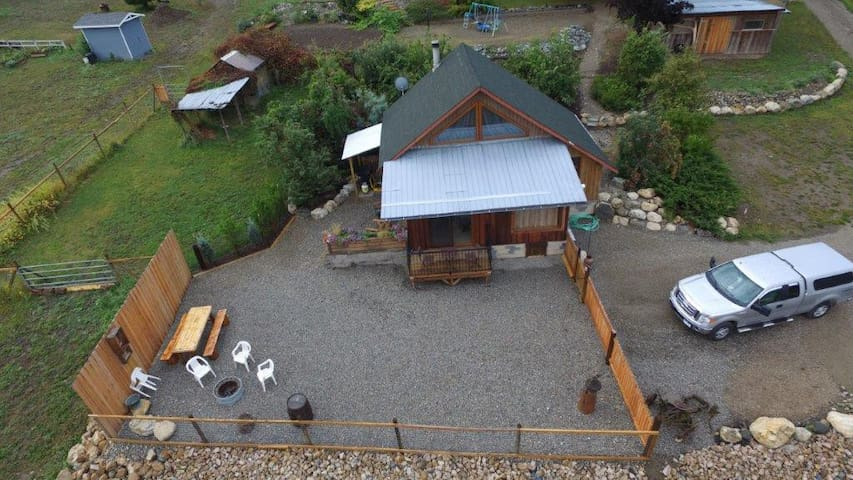 Birdseye-view of cabin, with lawn, gravel and parking area. Cabin, lawn and gravel area is all fenced in for your convenience.