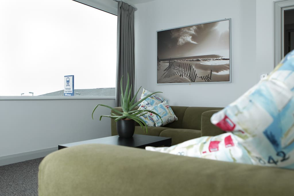Large living room with sea views and views of Barry's Big Dipper
