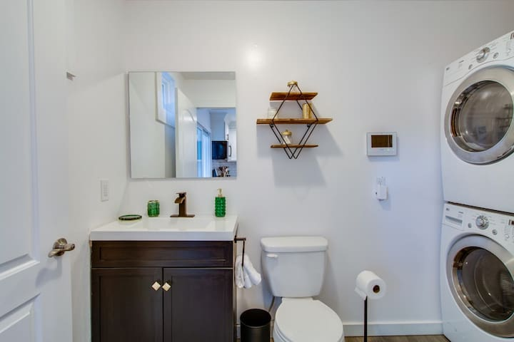 Full downstairs bathroom with a large mirror -- great for getting ready for the night!