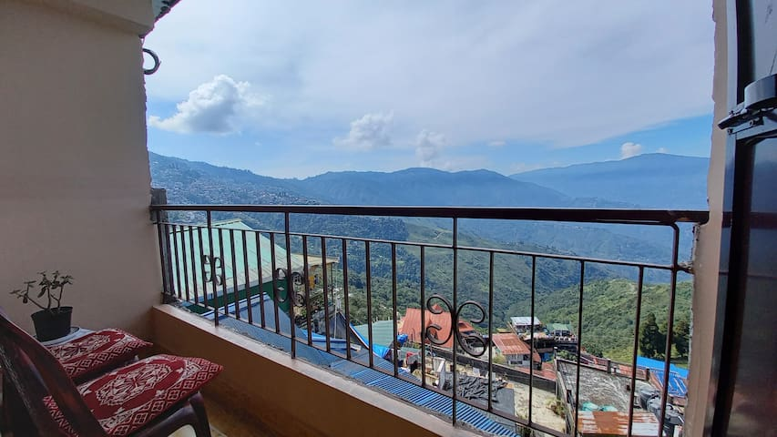 Balcony/Patio - The place comes with a private balcony attached to the bedroom which overlooks the scenic hills and tea gardens.