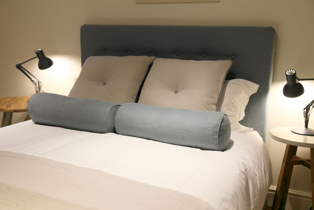 Comfortable king size bed with crisp white bed linen