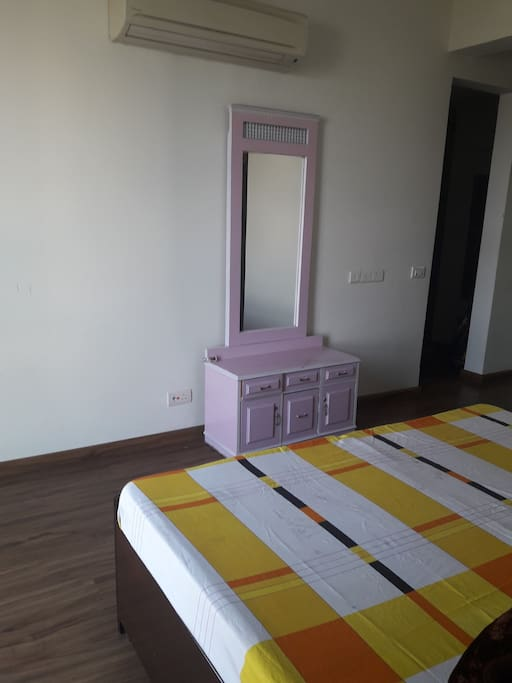 Spacious room with mirror and hard wood floor