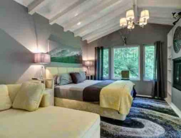 Master bedroom with sitting room and fireplace.